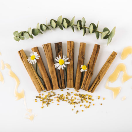 elevated-view-spices-flowers-honey-bee-pollen-white-surface_23-2147938049